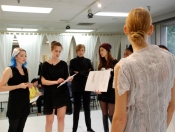 Stylist Amanda Mikko and students at fitting