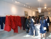 Wide shot of Morgan le Fay store and students