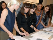 Morgan le Fay designer Liliana Casabal reviewing student sketches.
