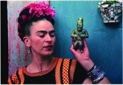 Frida Kahlo dons a bougainvilla head-dress.