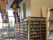 DVD shelves with electricians