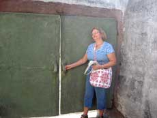 My sister Mary opening the huge concrete door