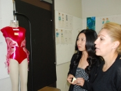 Mentors from Isobella & Chloe looking at student design